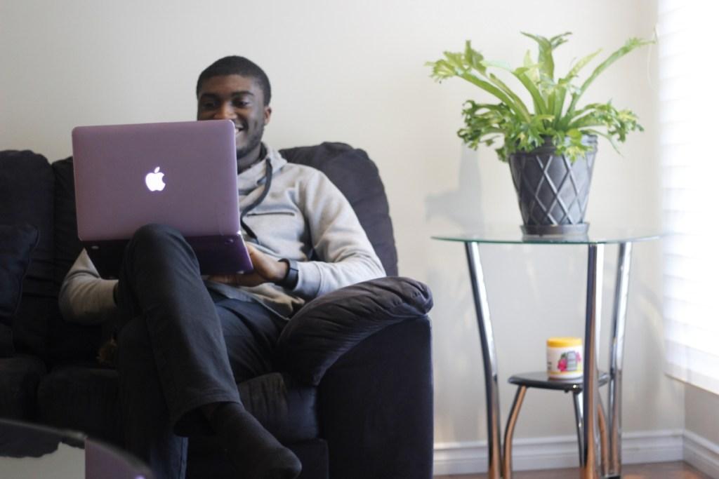 Samuel Osho with a Macbook
