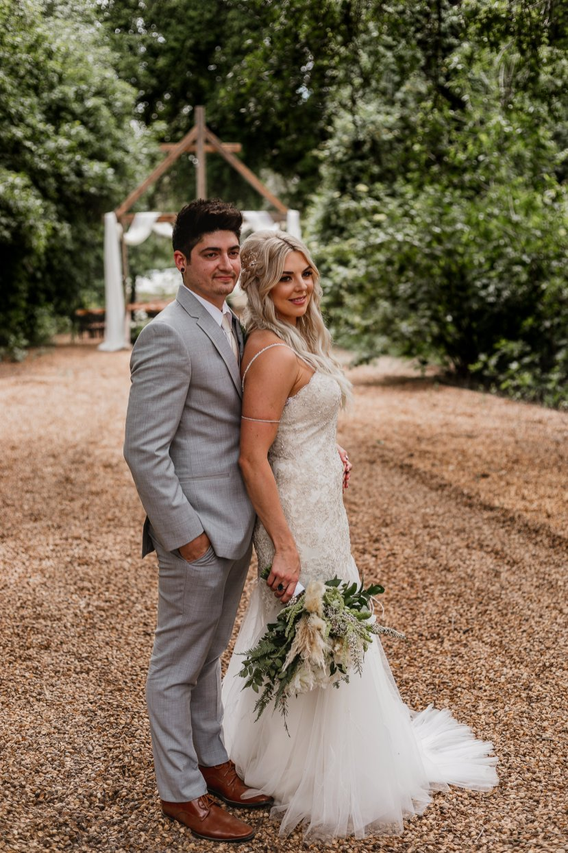 Bride and Groom Portraits at Horse Ranch Beneath Oak Trees