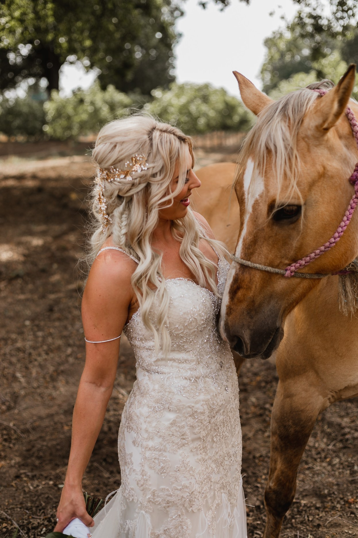 Gorgeous blonde bride with cream colored horse.