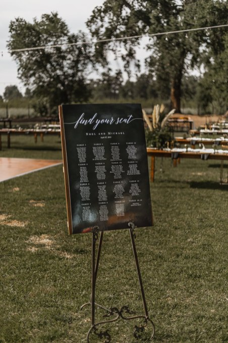 Gorgeous outdoor horse ranch wedding details and seating chart.