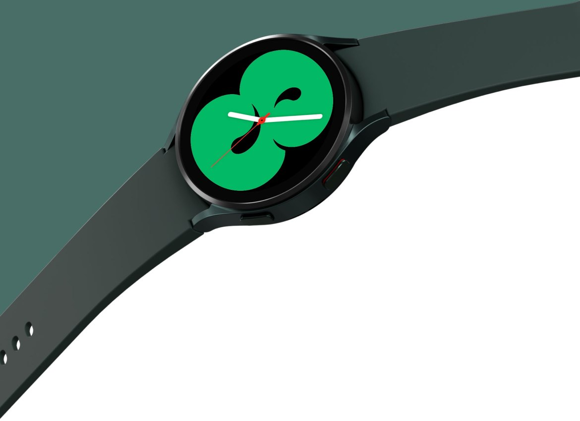 A green Galaxy Watch4 is displayed with a band that is spread wide. The watch face shows one of the designs that displays the time in a green color.