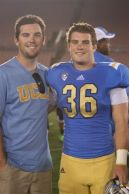 AJ, left, and Nick Pasquale on the field following a UCLA football game. Courtesy photo