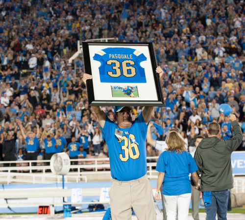 Mel Pasquale holds his son's jersey aloft at a UCLA home game last year. Photo: ASUCLA Photography
