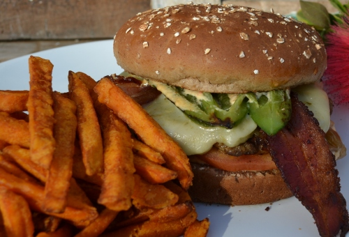 An avocado bacon cheeseburger with sweet potato fries served at Mission Grill. Courtesy Photo
