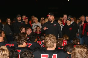 San Clemente football head coach Jaime Ortiz addresses the team following their 28-27 overtime win over Capistrano Valley on Nov. 28. Photo: Alan Gibby, zone57