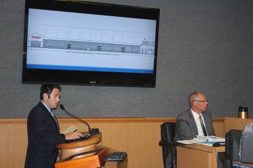 Associate Planner Sean Nicholas explains changes to proposed freeway-oriented signage for Sports Authority at Tuesday's City Council meeting, where the signage was rejected. Photo: Jim Shilander
