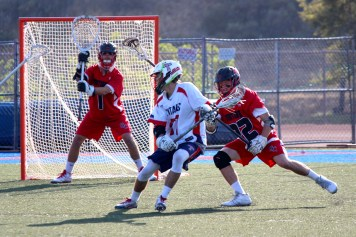 Caleb Bozarth, right, Austin Boyer (1) and the San Clemente boys lacrosse defense held strong in a 7-4 win over Tesoro on April 14. Photo: Kathy Renard