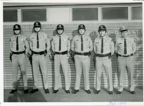 """(L to R): Stan Matchett, Don Anderson, Pat Grant, Albert """"Ace"""" Ehlow, Ardon Saunders and Norris Cole pose for a photo in 1967 in front of the San Clemente Police Services building. Photo: Lovell/Crummer Archives"""