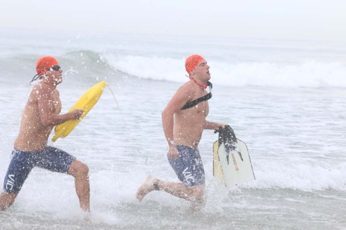 Lifeguard contestants take part in a San Clemente Ocean Festival competition. Photo: Eric Heinz