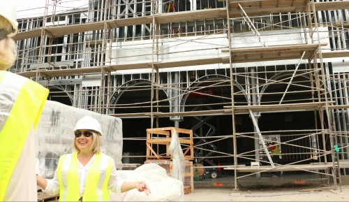 Nicky See, luxury marketing and communications professional of the Outlets at San Clemente, gives a tour of the construction site of the mall June 12. Photo: Eric Heinz