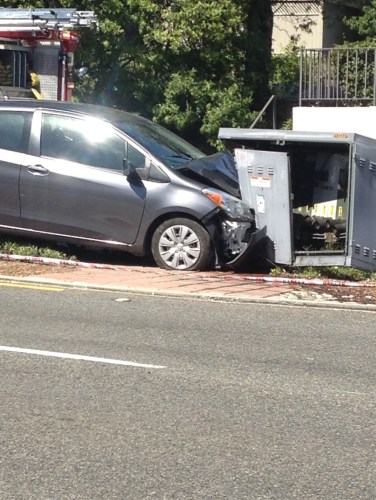 A car is still after a driver crashed it into an electrical box Friday afternoon that delivers power to the area of Camino De Los Mares in Capistrano Beach. Photo: Eric Heinz
