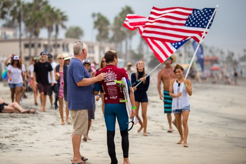 PHOTO: Team USA members and fans run to congratulate Colt Ward on Tuesday, Day 2 of the ISA World Junior Championship. Photo: ISA/Chris Grant