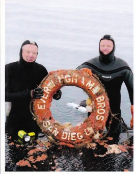 Bob Lohrman (left) and Roger Healy hold the A.C.E.'s life ring on the stern of the Early Bird II.  The two men dove the wreck for the first time. Photo: Ken Nielsen