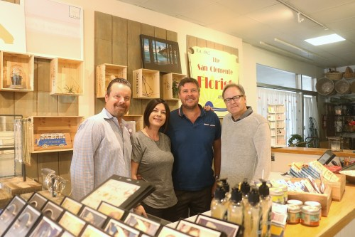(L to R): Bill St. Clair, director of Luxe Travel Club; Christina and Stuart Proctor, owners of San Clemente Florist and Gifts; and Craig Carter, president of Luxe Travel Club. Photo: Eric Heinz