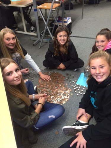 McKenna Nelson, Cecily Mitzev, Paige Russell, Bailey Dill and Morgan Mokler, students at Bernice Ayer Middle School, sit with money collected to raise funds for leukemia and lymphoma research. Photo: Courtesy of Toni Cummings