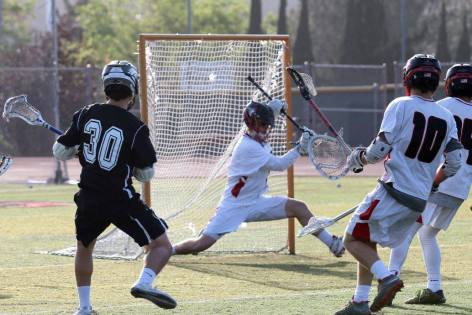 San Clemente lacrosse goalie Austin Boyer makes a save against Trabuco Hills on April 14. Photo: Courtesy