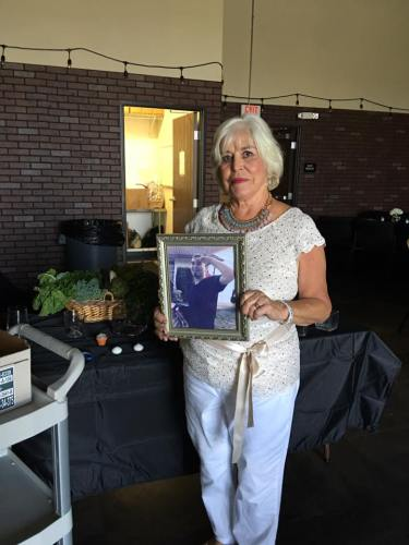 Cheryl Waller Shean holds a photo in honor of Dakota, a young person who died. Photo: Shelley Murphy