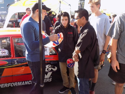 Abel Ibarra, a senior Pro Compact drag racing star, signs autographs to San Clemente High School Students. Photo: Lou Leto