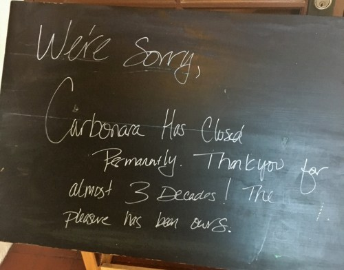 A sign was placed out front of Carbonara Restaurant on Thursday, April 27. Photo: Eric Heinz