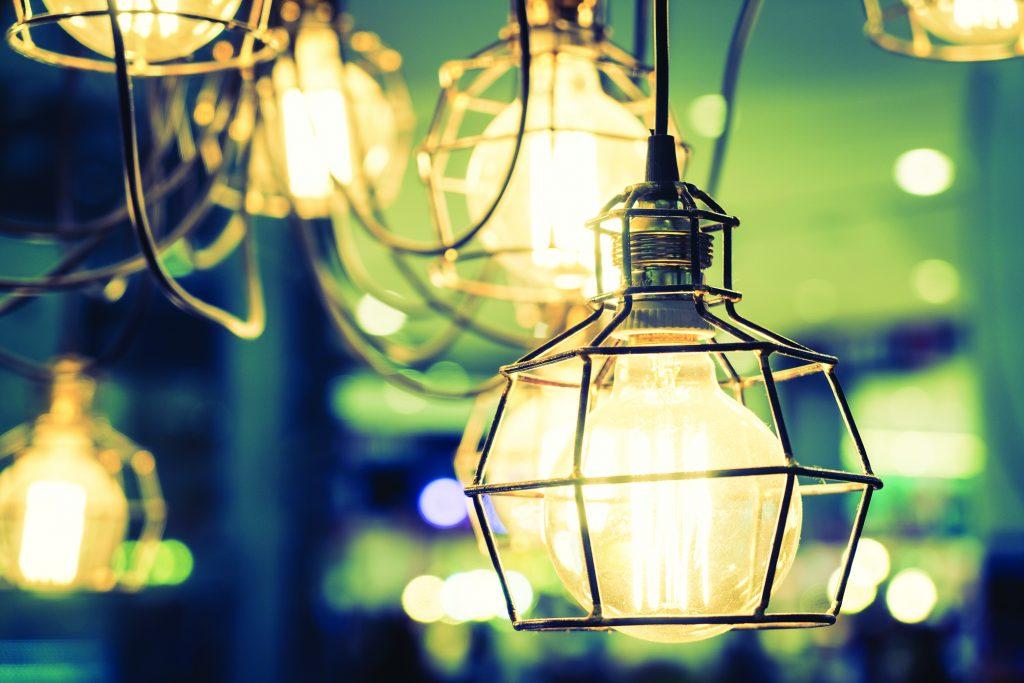 Soft focus on light bulb lamp decoration interior of room - vintage filter