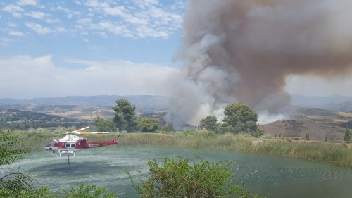 An Orange County Fire Authority Helicopter gathers water from a nearby water source on Wednesday, July 5, in south San Clemente. Photo: Courtesy of Mark Moran