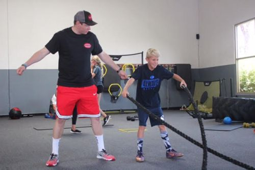 The LAB coach Brian Bang runs through a rope drill with a local athlete. Photo: Steve Breazeale