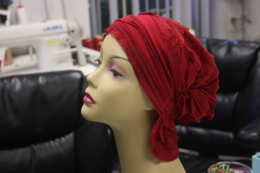 An example of the product Chemo Beanies produces rests on a mannequin. The elasticity of the beanie makes it accessible to nearly a one-size-fits all market. Photo: Eric Heinz