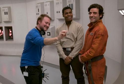 From left, Rian Johnson on set with John Boyega (Finn) and Oscar Isaac (Poe Dameron). Photo: David James/Copyright 2017 Lucasfilm Ltd.