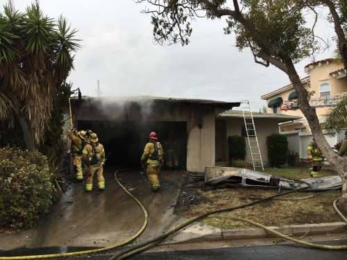 A garage was engulfed in flames on Jan. 9 at the 100 block of Avenida Buena Ventura in San Clemente. Firefighters had the fire controlled in 20 minutes, officials said. Photo: Courtesy of Orange County Fire Authority
