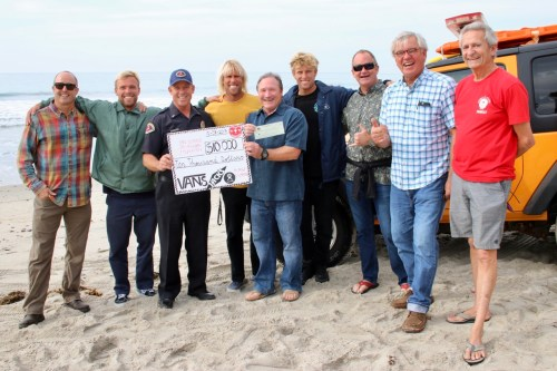 Positive Vibe Warriors present a $10,000 check to the San Clemente Lifeguard and Junior Guard Foundation. From left, Bill Blackwill, Tanner Gudauskas, Lt. Rod Mellott, Dane Gudauskas, Greg Hulsizer, Pat Gudauskas, John McMains, Tom Gudauskas and Jim Nielsen. Photo: Shelley Hulsizer.