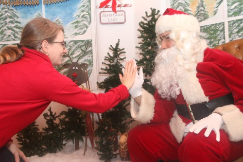 Santa Claus gets a high-five at last year's Christmas at the Casa. This year's events take place Saturday, Dec. 1, at the Casa and down Avenida Del Mar. Photo: File