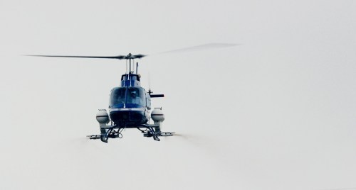 A helicopter makes a drop of larvicide on April 19 at Lower Trestles. Photo: Courtesy of Steve Kennedy