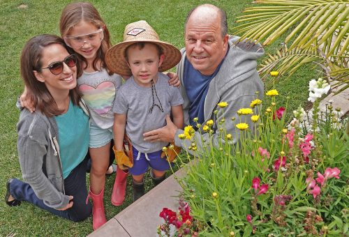 From left, Stephanie, Hadley and Hudson Roberts with the lil' landscaper's grandfather, Steve Zdrakas. / Photo: Fred Swegles