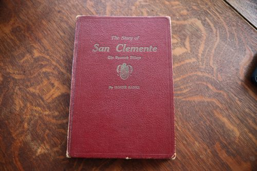 A Llamas family keepsake and original copy of The Story of San Clemente, by Homer Banks. Photo: Adam Gilles