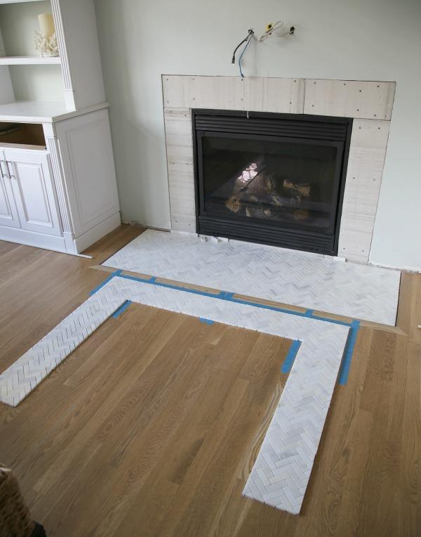 marble herringbone fireplace surround