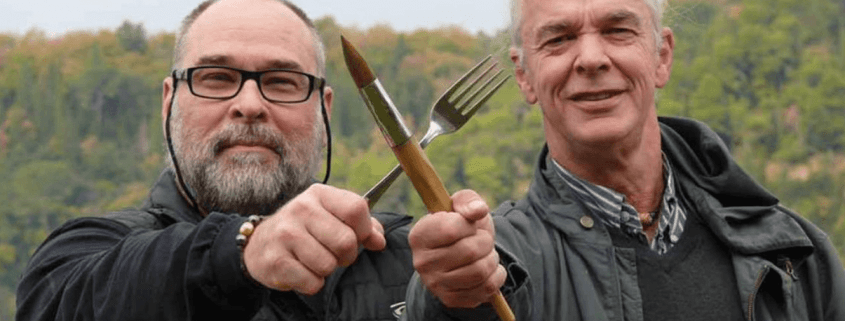 Robert St. John holding a fork and Wyatt Waters holding a paint brush