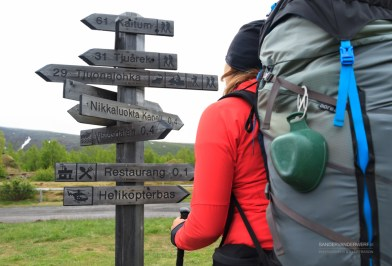 Wooden sings with hiking directions.