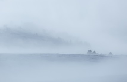 Clouds and fog over a snow covered plateau in the mountains. Vercors, France.