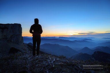 Female hiker looking at the tranquil sunset in the Vercors, France.