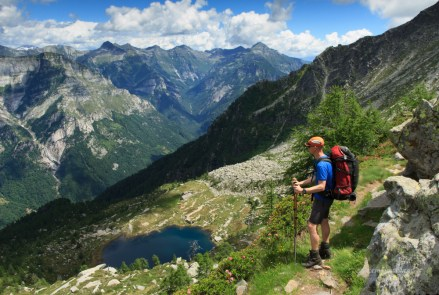 Hiker enjoying the view of the Ticino mountains.