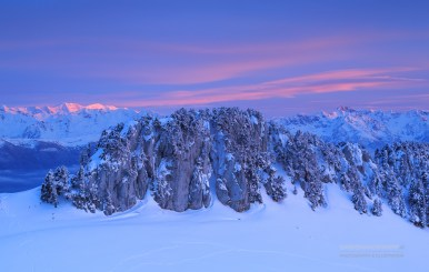 Rock formation on mountain range in French Alps during a colorful sunset.