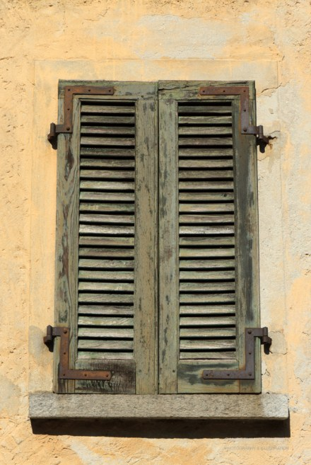 Shutters in an old house in Ticino.