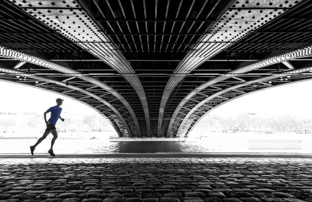 Me running under the Pont de l'Universite bridge on a warm, spring day.