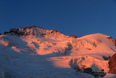 Mountainees on their way to the Barre des Ecrins during sunrise.