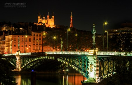 Illuminated bridge 'Pont de l'Universite' and cathedral 'Notre Dame de Fourviere'.
