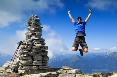 Man jumping out of joy on a mountaintop.