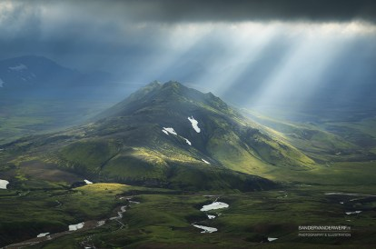 Sunbeams shining through the dark clouds on the Laugavegur hiking trail.