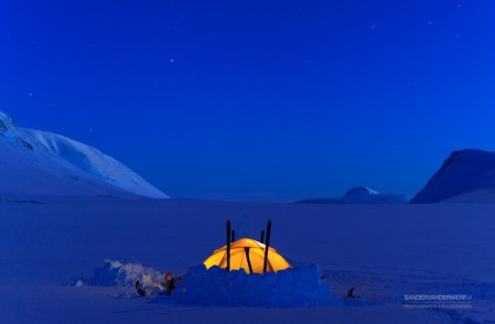 Tent in the snow during a cold night in the mountains.