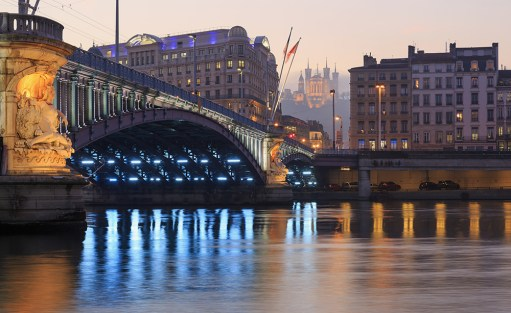 Illuminated bridge, Pont Lafayette, over the Rhone river at dusk.