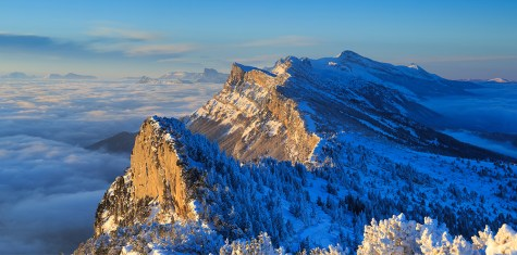 Snow covered mountain range of the Vercors, during a winter sunrise.